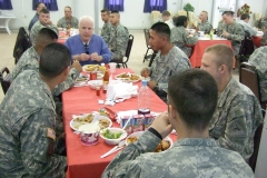 Senator John McCain sharing lunch with service members in Iraq, 2006